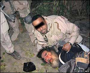Saddam manhandled after capture