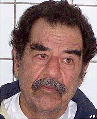 The captured Saddam Hussein after a haircut and a shave
