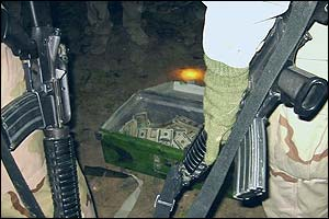 A briefcase full of US notes lies at the feet of US soldiers