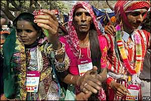 Two Indian eunuchs (centre and right) join Indian low-income widows in a protest march