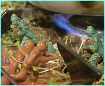 Here the two armies battle it out against each other on the kitchen hob - created on a landscape of melted chocolate and cress, to represent mud and grass