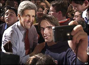 Senator Kerry has his picture taken with a supporter at his campaign party