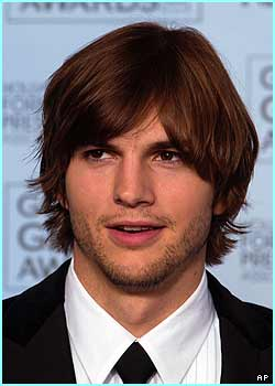 Ashton Kutcher sports a very weak beard and moustache for the occasion!