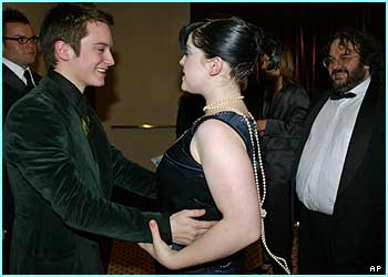And Elijah Wood and Kelly Osbourne greet each other like the old friends that they are, at an aftershow bash