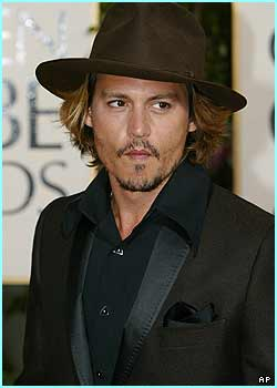 Jonny Depp is more Gentleman of the Carribean than Pirate as he arrives for the Golden Globe awards, 2004