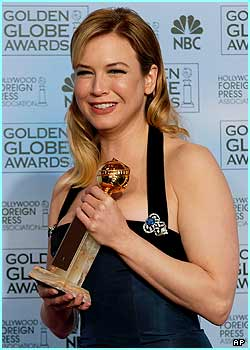 Renee Zellweger is all cheesy smiles after winning the award for best supporting actress for Cold Mountain