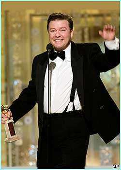Ricky Gervais looks well chuffed, and so he should be, becoming the first UK star ever to win best actor in a musical or comedy category for The Office
