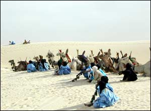 Camels and Tuareg nomads wait for the start of the festival