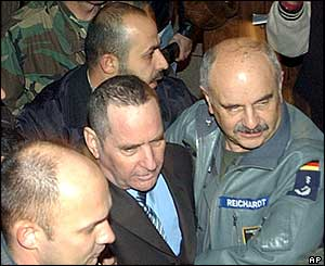 Elhanan Tannenbaum surrounded by German and Lebanese security guards