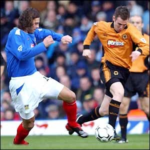 Patrick Berger tries to tackle Wolves' Kenny Miller
