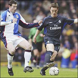 Blackburn's Brett Emerton challenges Chelsea's Scott Parker