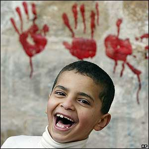Palestinian boy in east Jerusalem/red handprints