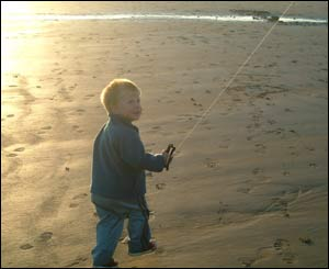 Three-year-old Osian Owens flying a kite at Sandy Haven Beach, Milford Haven in west Wales (Adrian Owens)