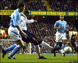Ledley King strikes the ball to score Tottenham's opening goal