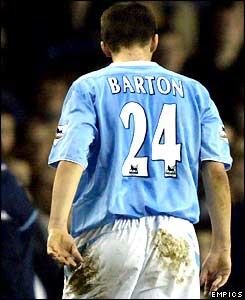 Joey Barton trudges off the pitch