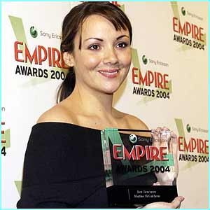 Ex-EastEnder Martine McCutcheon happily accepted her best newcomer award for her role in Love Actually.