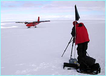 Here's Paul filming the Twin Otter plane landing at Mars Oasis. They use these planes to take the scientists all over Antarctica to do their work.