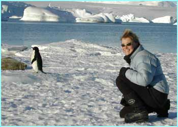 Here's Lizzie with an Adelie penguin - and a Weddell seal. There are around 5 million penguins on the continent.