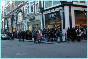 The queue snakes around one corner...