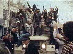 Civilians brandishing guns on an armoured car