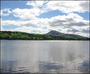 A mirror-like Lake Bala on a clear still day, taken by Chris Burtenshaw from Aberystwyth