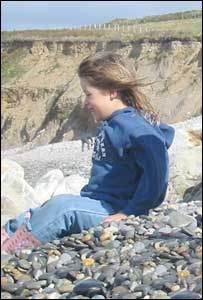 Elen Haf Thomas smiling at the sea at Abermawr Pembrokeshire