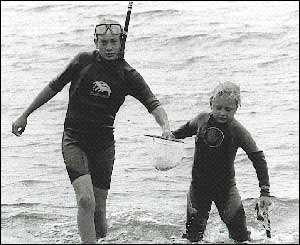 Jacqueline Filby's son Jamie visiting from New Mexico USA with his young cousin William snorkelling around Criccieth Beach