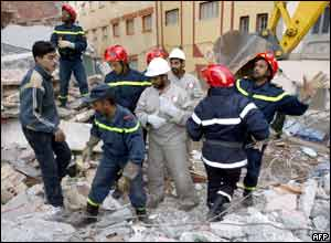 Rescuers from the Moroccan Red Crescent search for survivors in the rubble in the north-eastern village of Imzouren