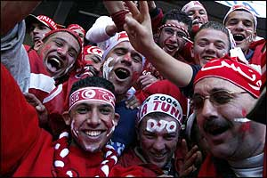 Tunisia fans wear their team's colours with pride