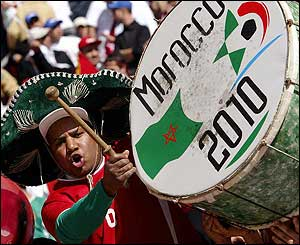 A musical fan cheers on Morocco ahead of the final