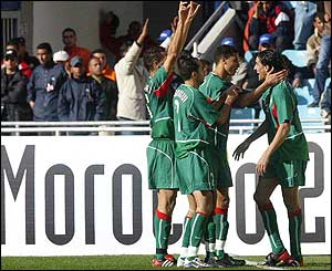 Youssef Hadji is congratulated by team-mates