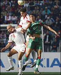 Tunisia midfielders Mdehi Nafti and Zied Jaziri fight for the ball against Morocco's Matouane Chama