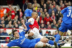 Chelsea captain John Terry makes a great tackle to stop Arsenal's Gilberto