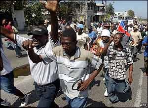 Anti-Aristide protesters march in Port-au-Prince