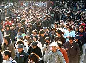People queue in Hibiya Park near the Tokyo District Court to try and get a seat