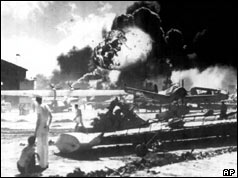 US aircraft in flames as Japanese planes bomb Pearl Harbor
