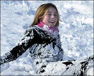 Young girl plays in snow