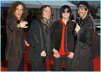 The Darkness look happy - probably because they've been nominated for four awards!