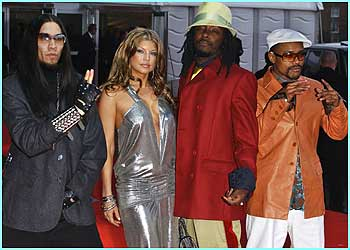Are The Black Eyed Peas just striking a pose - or trying to communicate something with their hand signals?