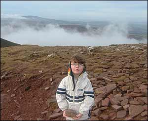 Philip Coleman's four-year-old daughter Emily collecting rocks at the top of Pen-y-fan