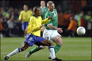 Brazil's Ze Roberto tries to get the ball away from Graham Kavanagh