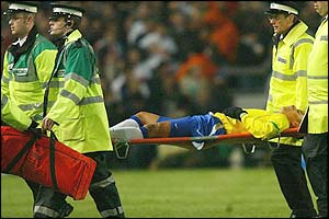 Gilberto Silva is carried off with a leg injury in the first half