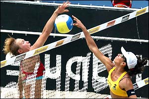 Germany's Claasen Deister attempts to block a spike from Ana Paula-Sandra Pires of Brazil