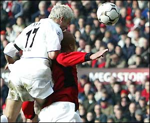 Leeds' Alan Smith beats Wes Brown to the ball to score the equaliser