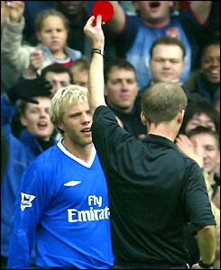 Eidur Gudjohnsen is shown the red card by Mike Riley