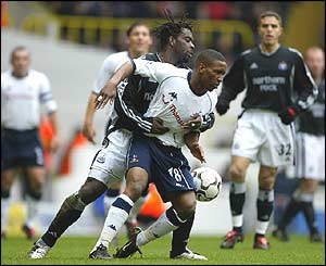Olivier Bernard of Newcastle and Spurs' Jermain Defoe
