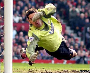 Scott Carson makes a diving save for Leeds