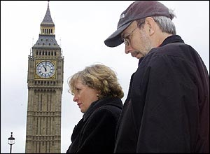 People stand in silence in front of London's Big Ben