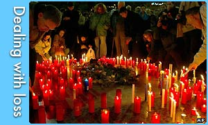 People light candles for the victims of the attack on intercity trains and train stations in Madrid