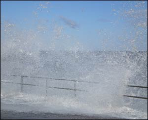 Waves crash at Colwyn Bay, as captured by Paul Daly